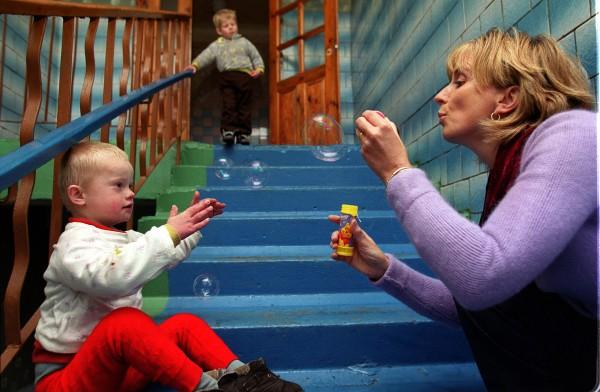 Adi & child in Vesnova mental asylum JB