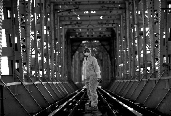 Adi Roche stands at the entrance of the Dnieper River bridge that crosses over to the Chernobyl nuclear poewr plant. Picture by Julien Behal (2003).