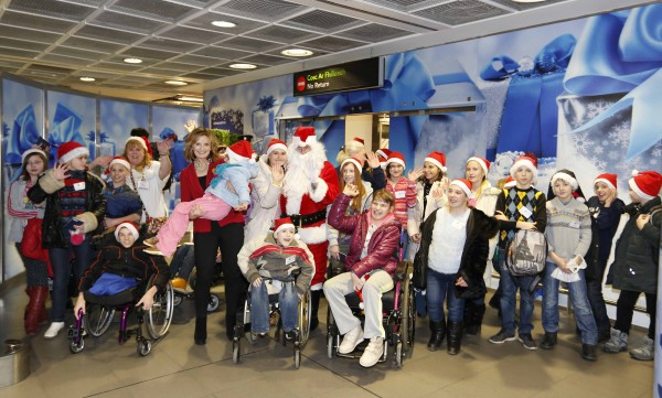 20/12/2015 Chernobyl Childrens International bring children from Chernobyl to Ireland. CEO of Chernobyl Childrens International Adi Roche(red jacket) with Chernobyl children arrive in Ireland for Christmas rest and recuperation stay today December 20th. Pictured are xxxxxx on arrival from Chernobyl at Dublin Airport. Chernobyl Childrens International brought 31 children from the heart of the Chernobyl regions in Belarus to Ireland this year. Photography: Sasko Lazarov/PhotocallIreland