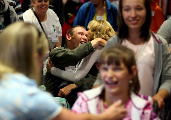 Friday, June 26, 2015: A very special group of 30 children from Belarus landed at Dublin Airport today (Friday, June 26th) as part of an urgent mercy mission by Adi Roche's Chernobyl Children International (CCI) to airlift children out of the region and away from lethal forest fires for respite care in Ireland this summer. Pictured was Sasha Leukin with Adi Roche. Picture Jason Clarke Photography.