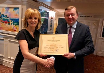 Ambassador Sergei Aleinik bestows Adi Roche with a certficiate of distinction