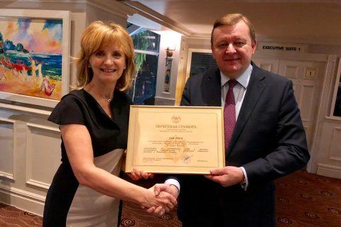 Ambassador Sergei Aleinik bestows Adi Roche with a certficiate of distinction