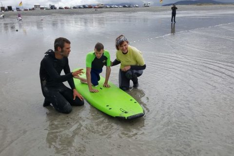 Igor taking a suft lesson during his first time braving the sea