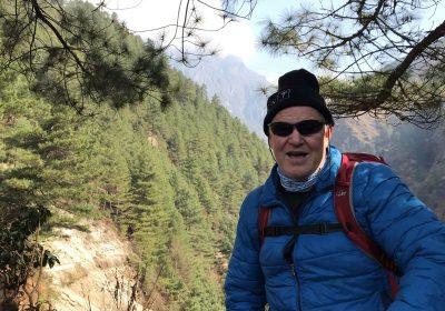Ken climbing a mountain